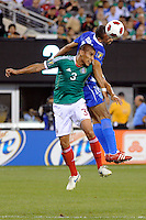 Carlos Salcido (3) of Mexico and Oscar Isaula (18) of Guatemala. Mexico defeated Guatemala 2-1 during a quarterfinal match of the 2011 CONCACAF Gold Cup at the New Meadowlands Stadium in East Rutherford, NJ, on June 18, 2011.