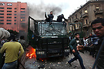 A mob of protesters vandalize an abandoned police carrier on Ramsis Street, Cairo, Egypt, Friday, Jan. 28, 2011. Tens of thousands of people took to the streets after Friday prayers, demanding that President Hosni Mubarak step down. Demonstrators clashed with police throughout the day and night as they marched toward Tahrir Square.