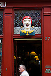 Jester figurehead outside Van der Gaag Pharmacy, The Hague, The Netherlands, in business since 1776.