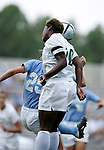 Jennifer Williams (20), of UAB, jumps over UNC's Lindsay Tarpley (25) to head the ball on Sunday September 18th, 2005 at Duke University's Koskinen Stadium in Durham, North Carolina. The University of North Carolina Tarheels defeated the University of Alabama-Birmingham Blazers 4-0 during the Duke adidas Classic soccer tournament.