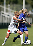 Lindsay Vera (13), of NC State, and Duke's Kelly McCann (r) challenge for the ball on Sunday October 2nd, 2005 at SAS Stadium in Cary, North Carolina. The Duke University Blue Devils defeated the North Carolina State University Wolfpack 1-0 during an Atlantic Coast Conference women's soccer game.