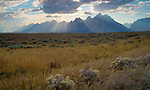 Wyoming, Rays of light stream over the Teton Range in autumn.