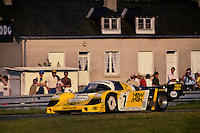 LE MANS, FRANCE - JUNE 17: The winning New-Man Joest Racing Porsche 956B 117 of Henri Pescarolo,  Klaus Ludwig and Stefan Johansson is driven during the 24 Hours of Le Mans FIA World Sports Car Championship race at the Circuit de la Sarthe in Le Mans, France, on June 17, 1984.