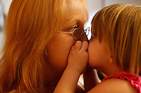 """Bragole kisses her granddaughter Jayme Smith in her FEMA trailer. Smith and her sister came to visit Bragole. """"That was healing for me to have all my grandkids together,"""" Bragole said."""