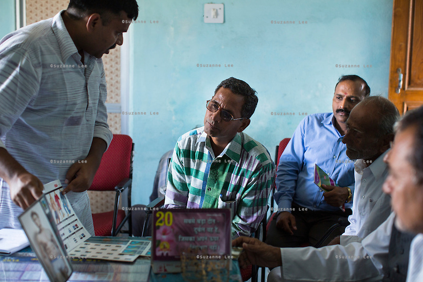 A Fairtrade personnel of India make a presentation to a small group of Fairtrade Cotton Farmer Leaders in Vasudha Vidya Vihar school in Khargone, Madhya Pradesh, India on 12 November 2014. Photo by Suzanne Lee for Fairtrade