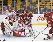 Ryan Carroll (Harvard - 35), Chris Connolly (BU - 12), Joe Pereira (BU - 6), Danny Biega (Harvard - 9), Conor Morrison (Harvard - 38) - The Harvard University Crimson defeated the Boston University Terriers 5-4 in the 2011 Beanpot consolation game on Monday, February 14, 2011, at TD Garden in Boston, Massachusetts.
