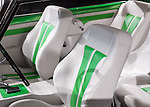 Classic retro car custom interior, white with green leather seats.