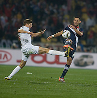 The USA's Clint Dempsey (8) fights for a loose ball with England's Steven Gerrard (4) in the first half of the 2010 World Cup match between USA and England in Rustenberg, South Africa on Saturday, June 12, 2010.