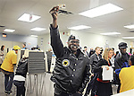 Cincinnati (Hamilton County), Ohio: October 2, 2012<br /> Early voter Hilliard Herring holds up his driver's license--a form of identification--toward election officials on the first day of voting in Ohio for the 2012 presidential election and other races. Hilliard cast a ballot for President Barack Obama. This location is the Hamilton County Board of Elections. (Point of clarification: For early voting, voters are not required to show an actual license or photo ID as a proof of identification. Election officials require voters to provide the numbers of a driver's license or the last four digits of a social security number.) &copy;Chris Fitzgerald / CandidatePhotos