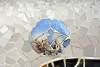 """Detail of """"trencadis"""", decoration with broken ceramic on the benches designed by Josep María Jujol (Tarragona 1879 - Barcelona 1949), Park Güell, Barcelona, Catalonia, Spain, 1900 - 1914, built by architect Antoní Gaudi (Reus 1852, Barcelona 1926). Full enlargement of the picture shows a baroque angel with redhead. Picture by Manuel Cohen"""