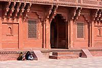 Fatehpur Sikri, Uttar Pradesh, India.  Women Talking in front of Diwan-i-Khas, the Emperor Akbar's Hall of Private Audience.