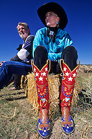 A participant offers some  colorful advice on her cowboy boots at the Lincoln County County Cowby Symposium, head each year in the fall in southern New Mexico