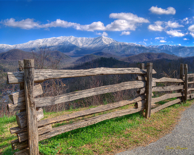 HDR image of the Great Smoky Mountains cloaked in snow as seen from the overlook above Gatlinburg, Tennessee.
