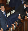 June 26, 2012, Tokyo, Japan - Japans Prime Minister Yoshihiko Noda, second from left, takes a deep bow after the House of Representatives passed the sales tax hike legislation with the backing of two main opposition parties by 363 to 96 votes in Tokyo on Tuesday, Juner 26, 2012.Ichiro Ozawa, the kingpin of the ruling Democratic Party of Japan, and his followers voted against the legislation, causing a severe division within the ruling party. At left is Deputy Prime Minister Katsuya Okada. (Photo by Natsuki Sakai/AFLO)