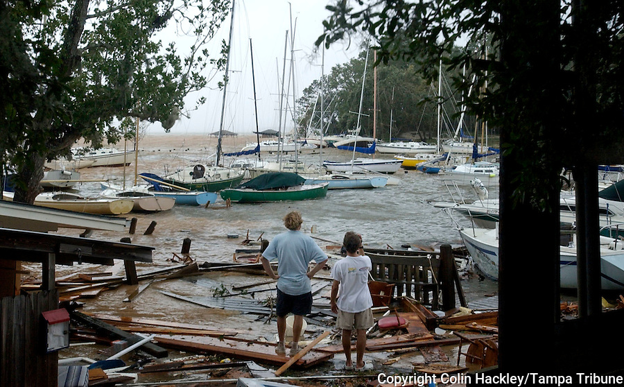 Fairhope, ALA 8/29/05-Zane Yoder of Daphne, Ala., left, and Ellis Ollinger of Fairhope, Ala. survey the mess made of the Fairhope Yacht Club after Hurricane Katrina came ashore Monday. COLIN HACKLEY PHOTO