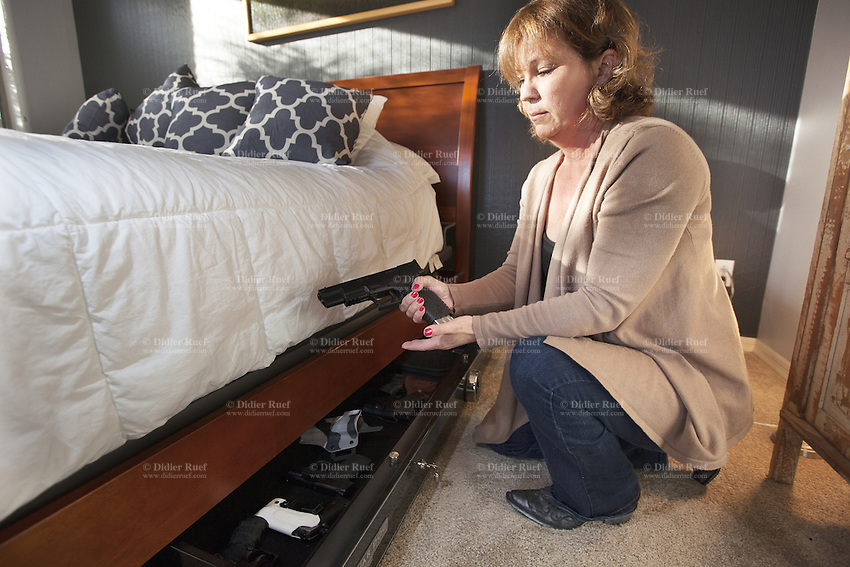 sell online resources for women gun owners she kneels in her bedroom