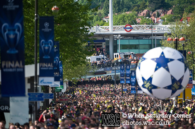 Bayern Munich 2 Borussia Dortmund 1, 25/05/2013. Wembley Stadium, Champions League Final. The first all-German Champions League final pitched Bayern, dominent domestically all season, against a Dortmund team who have troubled them so often in recent years. Fans and UFEA banners out in force along Wembley way. Photo by Simon Gill.