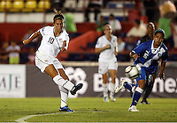 Carli Lloyd of USA (L) at the 2010 CONCACAF Women's World Cup Qualifying tournament held at Estadio Quintana Roo in Cancun, Mexico.