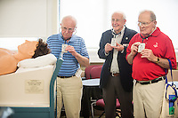 John Murray, M.D., left. Reunion 2013.