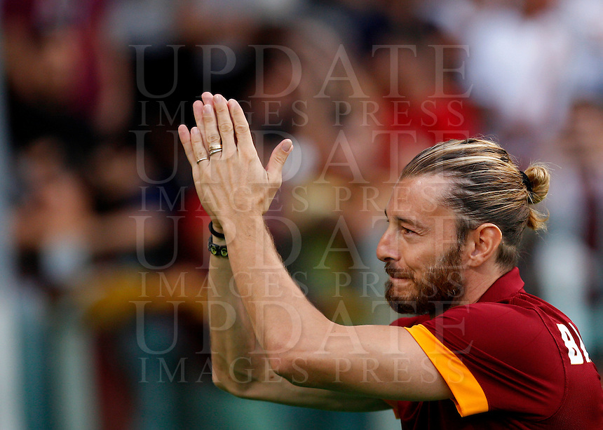 Calcio, amichevole Roma vs Fenerbahce. Roma, stadio Olimpico, 19 agosto 2014.<br /> Roma defender Federico Balzaretti greets fans during the team's presentation, prior to the friendly match between AS Roma and Fenerbahce at Rome's Olympic stadium, 19 August 2014.<br /> UPDATE IMAGES PRESS/Riccardo De Luca