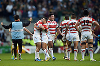 Japan players celebrate at the final whistle. Rugby World Cup Pool B match between South Africa and Japan on September 19, 2015 at the Brighton Community Stadium in Brighton, England. Photo by: Patrick Khachfe / Onside Images