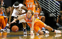 January 24, 2010; Baton Rouge, LA, USA; Tennessee Lady Vols guard Angie Bjorklund (right) and LSU Lady Tigers guard Allison Hightower (left) reach for a loose ball during the second half at the Pete Maravich Assembly Center. Tennessee defeated LSU 55-43. Mandatory Credit: Crystal LoGiudice-US PRESSWIRE .