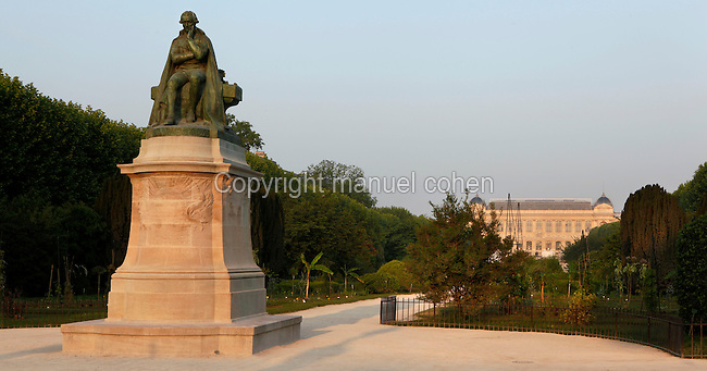 General view of the statue of Jean-Baptiste Pierre Antoine de Monet, Chevalier de la Marck, known as Lamarck, created by Leon Fagel in 1908 and located at the entrance of Carr»s de la perpective (the plots of Perspective), Valhubert Place, in the Jardin des Plantes, Paris, 5th arrondissement, France. In the distance can be seen the Grande Galerie de l'Evolution (Great Gallery of Evolution). Founded in 1626 by Guy de La Brosse, Louis XIII's physician, the Jardin des Plantes, originally known as the Jardin du Roi, opened to the public in 1640. It became the Museum National d'Histoire Naturelle in 1793 during the French Revolution. Picture by Manuel Cohen