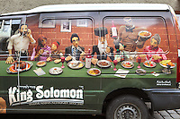 Van covered with an advertisement for the King Solomon restaurant showing a Jewish family eating a kosher meal, in the Jewish quarter or Josefov, Prague, Czech Republic. The historic centre of Prague was declared a UNESCO World Heritage Site in 1992. Picture by Manuel Cohen