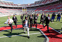 The Ohio State Buckeyes with head coach Urban Meyer, left, walk on to the field before the Ohio State football season opener against Buffalo at Ohio Stadium in Columbus, Saturday afternoon, August 31, 2013. (Columbus Dispatch  / Eamon Queeney)