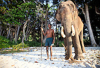 Rajan and caretaker mahout standing on the beach on Havelock Island, Andamans, India