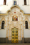 Travel stock photo of a Decorated with gold entrance door of the Mother of God Assumption church on the territory of Kievo-pecherskaya lavra - Kiev pechersk lavra - Cave monastery in Kiev Ukraine Eastern Europe Architecture in Ukrainian baroque architectural style Largest monastery in Russia Vertical orientation May 2007