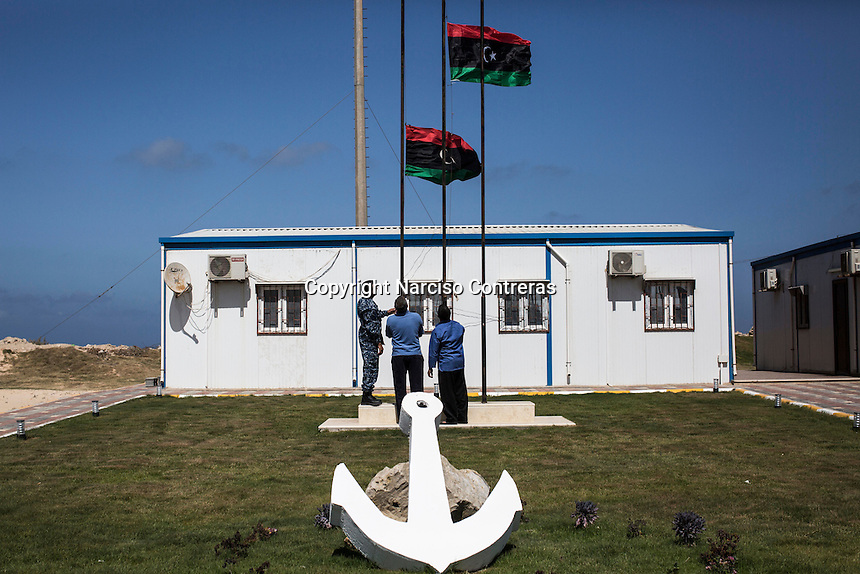 Saturday 21, May 2016: Coast guards rise up the revolutionary Libyan flag at their base in the harbor of Misrata City, Libya.