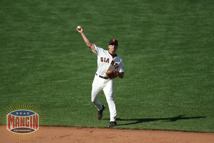 SAN FRANCISCO - June 23:  Omar Vizquel of the San Francisco Giants throws to first base during the game against the New York Yankees at AT&T Park in San Francisco, California on June 23, 2007. Photo by Brad Mangin