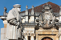 Statue of King John III or Joao III, 1502-57, who based the University permanently in Coimbra, and behind, the coat of arms over the main entrance to the Joanina Library, or Biblioteca Joanina, a Baroque library built 1717-28 by Gaspar Ferreira, part of the University of Coimbra General Library, in Coimbra, Portugal. The Casa da Livraria was built during the reign of King John V or Joao V, and consists of the Green Room, Red Room and Black Room, with 250,000 books dating from the 16th - 18th centuries. The library is part of the Faculty of Law and the University is housed in the buildings of the Royal Palace of Coimbra. The building is classified as a national monument and UNESCO World Heritage Site. Picture by Manuel Cohen