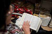 A woman prays in the back store room of Danel Feinkost Kosher Food. The store is the only all kosher foods store in Munich, Germany.