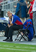 24 July 2010: FC Dallas coach Schellas Hyndman watches the reply on the jumbo screen during a game between FC Dallas and Toronto FC at BMO Field in Toronto..The final score was a 1-1 draw...