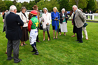 Jockey Holly Doyle talks to connections of Billesdon Bess in the parade ring during Afternoon Racing at Salisbury Racecourse on 18th May 2017