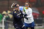 01 March 2015: Notre Dame's Kiera McMullan (1) and Duke's Katie Trees (behind). The Duke University Blue Devils hosted the University of Notre Dame Fighting Irish on the West Turf Field at the Duke Athletic Field Complex in Durham, North Carolina in a 2015 NCAA Division I Women's Lacrosse match. Duke won the game 17-3.
