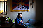 A Tibetan-in-exile, Sonam Choden poses for a portrait in her house in Kathmandu, Nepal. Photo: Sanjit Das/Panos