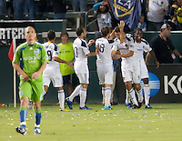 LA Galaxy players celebrate Omar Gonzalez's goal during the first half of the game between LA Galaxy and the Seattle Sounders at the Home Depot Center in Carson, CA, on November 7, 2010. LA Galaxy 2, Seattle Sounders 1. LA Galaxy advance in the playoffs with an aggregate score of 3 to 1.