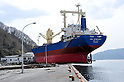 April 1st, 2011, Kamaishi, Japan - Asia Symphony, a Panamanian ocean going vessel, remains aground on the wharf in the port of Kamaishi , Iwate Prefecture, on April 1, 2011, three weeks after this major northeastern Japanese port was destroyed by a magnitude 9.0 earthquake and ensuing tsunami. (Photo by Natsuki Sakai/AFLO) [3615] -mis-.....