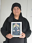 Rosa Majeed Nouri holds a photo of her son Fawaz at her home in a camp for displaced Iraqis in Dawodiya, Iraq, on April 10, 2016.  He was killed two months earlier while fighting against ISIS near Telskuf as a member of a Christian militia called the Nineveh Plain Protection Forces.