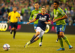 New England Revolution Kevin Rowe (11) passes the ball off  during an MLS match against the Seattle Sounders on March 8, 2015 in Seattle, Washington.  The Sounders beat the Revolution 3-0.  Jim Bryant Photo. ©2015. All Rights Reserved.