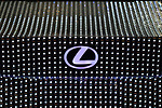 "Manhattan, New York, USA. April 12, 2017.  Closeup view of Levus logo area of trunk is shown of Lexus LIT IS 2017 sedan - covered with 41,999 tiny LED light units programmed to create changing patterns and colors - on display at the New York International Auto Show, NYIAS, at the Javits Center. The car had appeared during New York Fashion Week and is featured in UK artist Dua Lipa's music video for her song ""Be the One."""