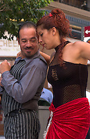 Tango performers dance on Calle Florida in downtown in Buenos Aires. Noted Argentine author Jorge Luis Borges wrote often about people on the margins in the Buenos Aires of the early 20th Century -- thugs, knife fighters, prostitutes and scoundrels who danced the tango in dangerous bars. The magic realist author influenced the work of many of the western hemisphere's greatest writers.<br />