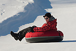 Teenage Boy on  Otep&auml;&auml; Snowtubing Track, Valga County,  Estonia