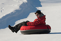 Teenage Boy on  Otepää Snowtubing Track, Valga County,  Estonia