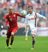 FUSSBALL   1. BUNDESLIGA  SAISON 2011/2012   29. Spieltag FC Bayern Muenchen - FC Augsburg       07.04.2012 Arjen Robben (li, FC Bayern Muenchen) gegen Daniel Baier (FC Augsburg)