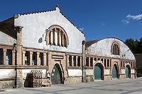 The Gandesa Cooperative Wine Cellar (Bodega Cooperativa Gandesa), 1919, Cesar Martinell i Brunet (1888 - 1973), Gandesa, Priorat, Tarragona, Spain. The main part of the building consists of three rectangular naves, which are parallel to each other. The roof is made with architecture more characteristic of Modernist cellars: bricks and a Catalan vault. Picture by Manuel Cohen
