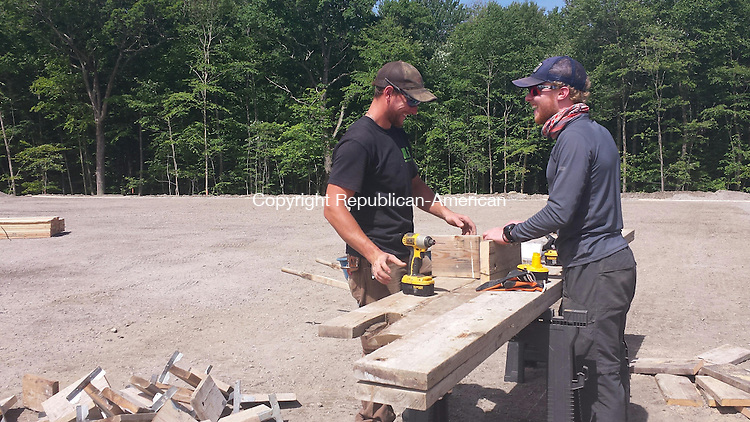 THOMASTON, CT, 05 June 2015 - 060515LW04 - Andrew Yannes, left and Zach Yannes work on the new tennis court at Nystrom's Park in Thomaston Friday morning. The men both work for RS Site and Sports of Seymour. Laraine Weschler Republican-American